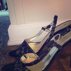 Versace sling back heel. Gold with black lace.